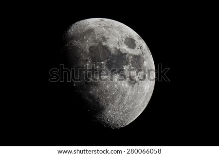 Half moon in the middle of its way on the clear sky. - stock photo