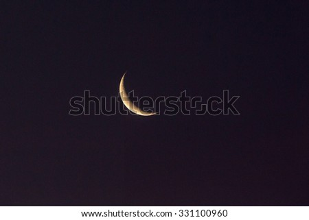 Half moon in the night sky - stock photo