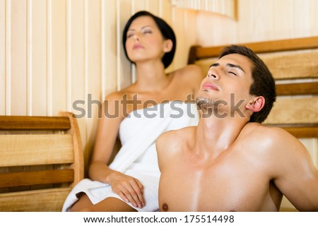 Half-naked man and female relaxing in sauna. Concept of self-care, health and relaxation - stock photo