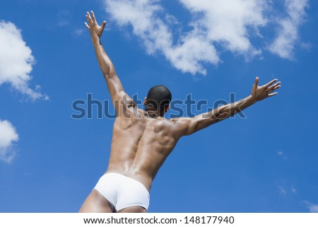 Half-naked man with arms outstretched
