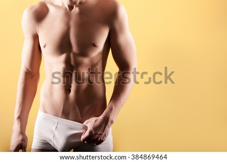 Half naked sexy body of muscular athletic man - stock photo