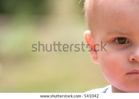 half of a baby boy's face - stock photo