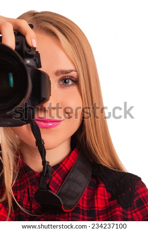 Half of a face of female photographer holding a professional camera - isolated over white - stock photo