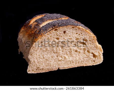 half of a homemade Organic Bread loaf. isolated on Black - stock photo
