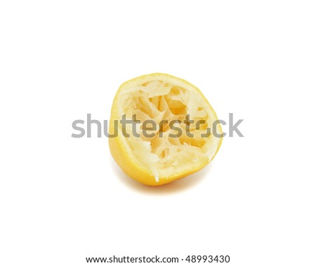 Half of aged and juicy lemon, isolated on a white background