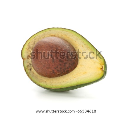 Half of avocado with seed. Isolated on white