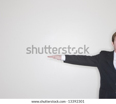 half of businessman standing wearing suit with one arm out straight - stock photo