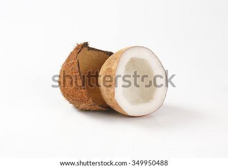 half of coconut on white background