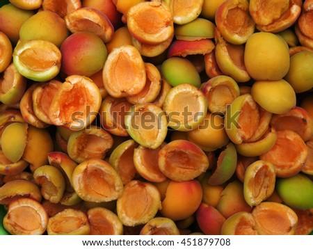 half of fresh ripe apricots - stock photo
