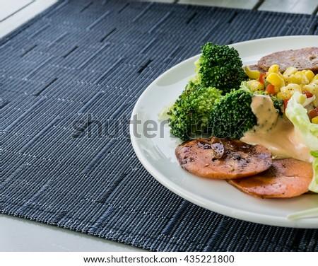 Half of fresh salad meal. Breakfast meal. Healthy food. - stock photo