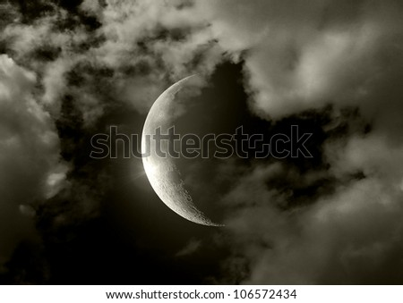 Half of moon in the night black sky - stock photo