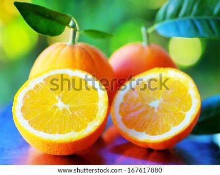 Half of orange fruits - stock photo