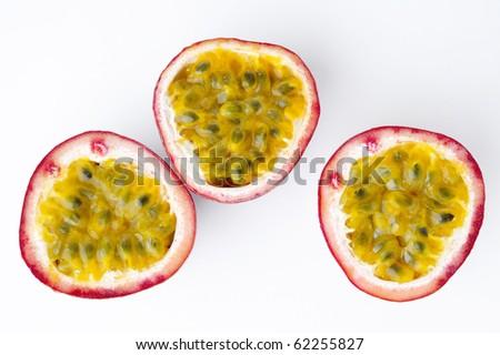 half of passion fruit on white background - stock photo
