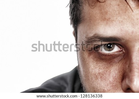 Half of scary face with green eye - stock photo