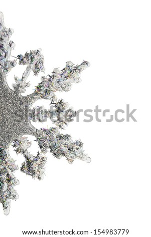 Half of silver snowflake decorated with tinsel isolated over white