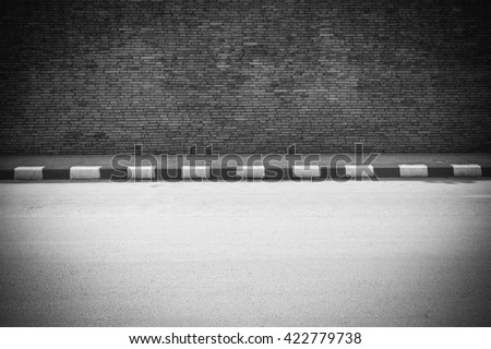 Half of street with wall, monotone style  - stock photo