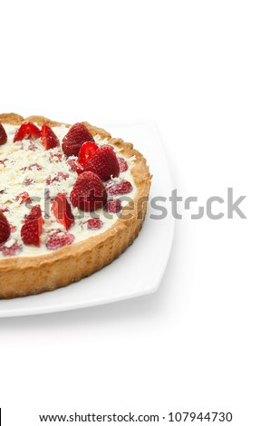 half of the cake with strawberries filled with cream isolated