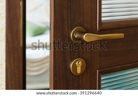 Half open door of a hotel bedroom or apartment. - stock photo