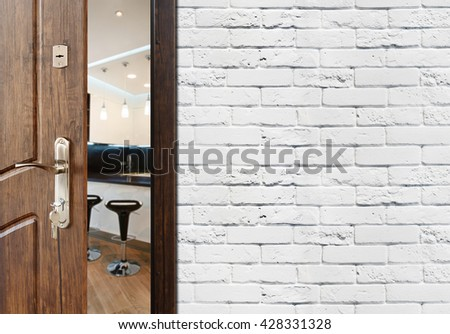 Half opened door to a kitchen. Welcome concept. Entrance to the room.