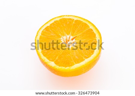 Half orange fruit on white background, fresh and juicy.