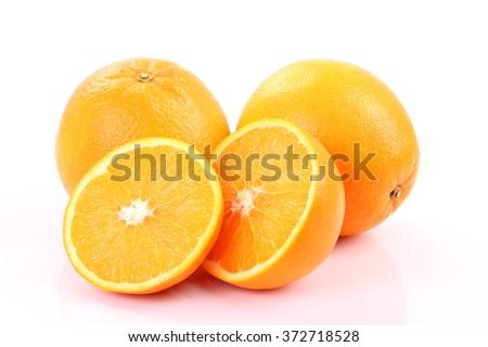 Half orange fruit on white background, fresh and juicy - stock photo