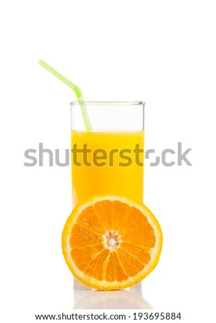 half orange in front of glass of orange juice with straw on white background with space for text