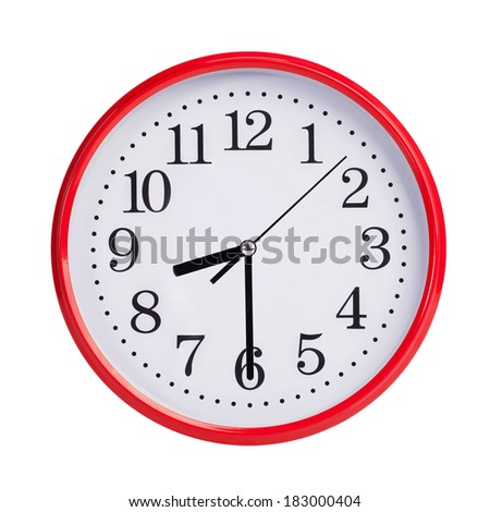 Half past nine on a red round clock face