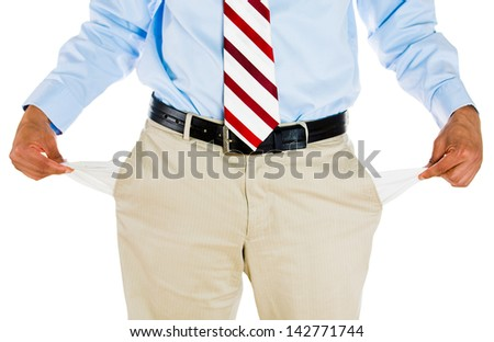 Half portrait of man pulling out empty pockets, isolated on white background - stock photo
