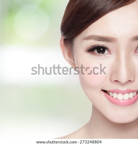 Half portrait of the woman with beauty face, perfect skin and health teeth, she smile to you isolated on nature green background, asian beauty - stock photo