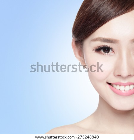 Half portrait of the woman with beauty face, perfect skin and health teeth, she smile to you isolated on blue background, asian beauty - stock photo