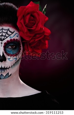 Half portrait of woman in professional makeup for halloween.
