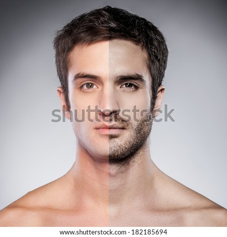 Half shaved. Handsome young man with half shaved face looking at camera while standing against grey background - stock photo