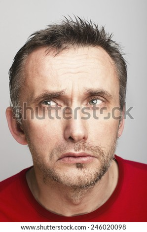 Half shaved male is pretending memory problem. - stock photo