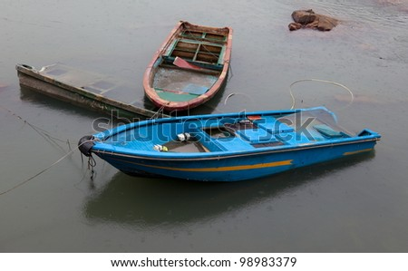 Half submerged small boats. Cheung Chau. Hong Kong.