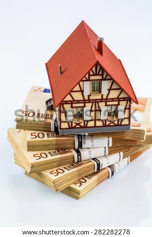 half-timbered house on euro banknotes, symbol photo for home purchase, financing, building society - stock photo
