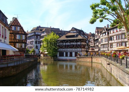 Half timbered houses along the canals of the Petite France neighborhood of Strasbourg - stock photo
