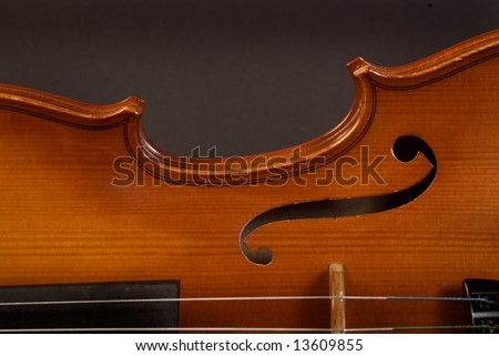 half Violin side on dark gray background - stock photo