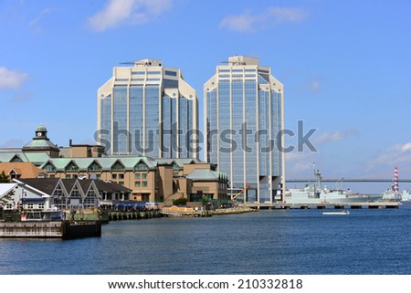 Halfiax waterfront with Naval Battleship and MacDonald Bridge in background - stock photo