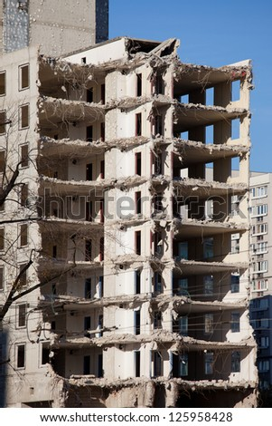 Halfway finished demolishing of a multi-storey old apartment building in Warsaw, Poland. - stock photo