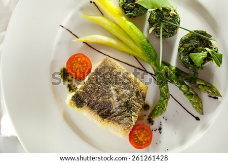 Halibut Fillet with Asparagus and Spinach - stock photo