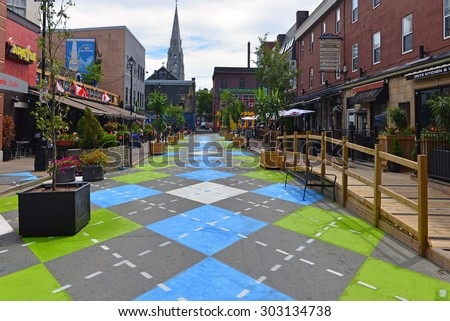 HALIFAX, CANADA AUG 3, 2015:  Argyle Street in Halifax, Nova Scotia, famous for its trendy bars and restaurants, with a new Argyle paint job on the section that has been closed to traffic. - stock photo