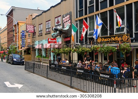 HALIFAX, CANADA - AUG 3, 2015:  Argyle Street which contains several bars and restaurants on a summer afternoon in the city which is known for its night life. - stock photo