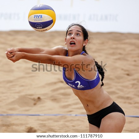 HALIFAX, CANADA - AUGUST 31: Claudia Rios of Mexico competes at the FIVB Beach Volleyball Swatch Junior World Championships on Aug. 31, 2012 in Halifax, Canada. - stock photo