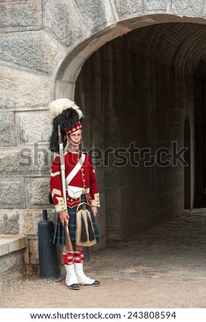 HALIFAX, CANADA - AUGUST 24: Guard standing by the gates of Halifax Citadel on August 24, 2008. Guard in historic uniform at Citadel National historic site in Halifax, Canada. - stock photo
