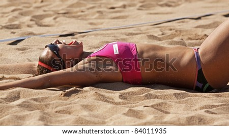 HALIFAX, CANADA - SEPTEMBER 3: Canada's Victoria Altomare celebrates her team's win at the FIVB Beach Volleyball Swatch Junior World Championships on Sept. 3, 2011 in Halifax, Canada.