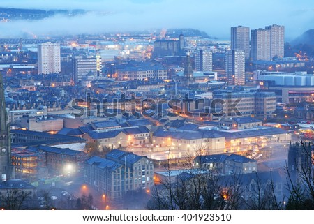 HALIFAX, UK - APRIL, 13, 2016: Aerial view of Halifax just before sunrise, West Yorkshire, UK with a low-level mist covering some of the buildings