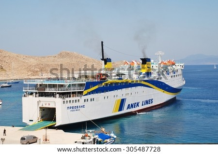 HALKI, GREECE - JUNE 16, 2015: ANEK Lines ferry Prevelis docked at Emborio harbour on the Greek island of Halki. The 142.5mtr ship was built in Japan in 1980 and refitted in 1994. - stock photo