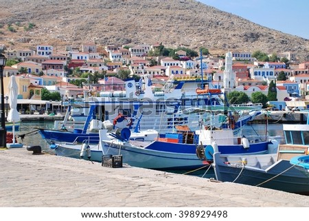 HALKI, GREECE - JUNE 5, 2015: Boats moored in the harbour at Emborio on the Greek island of Halki. The Dodecanese island has a population of under 300 people.