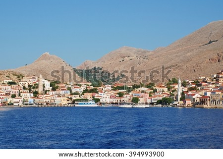 HALKI, GREECE - JUNE 17, 2015: Looking towards the village of Emborio on the Greek island of Halki. The Dodecanese island near Rhodes has a population of under 300 people.