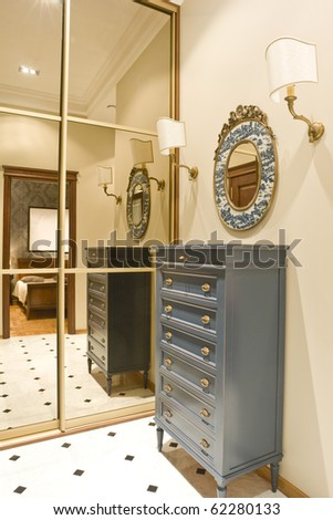 hall and cabinet with big mirror - stock photo